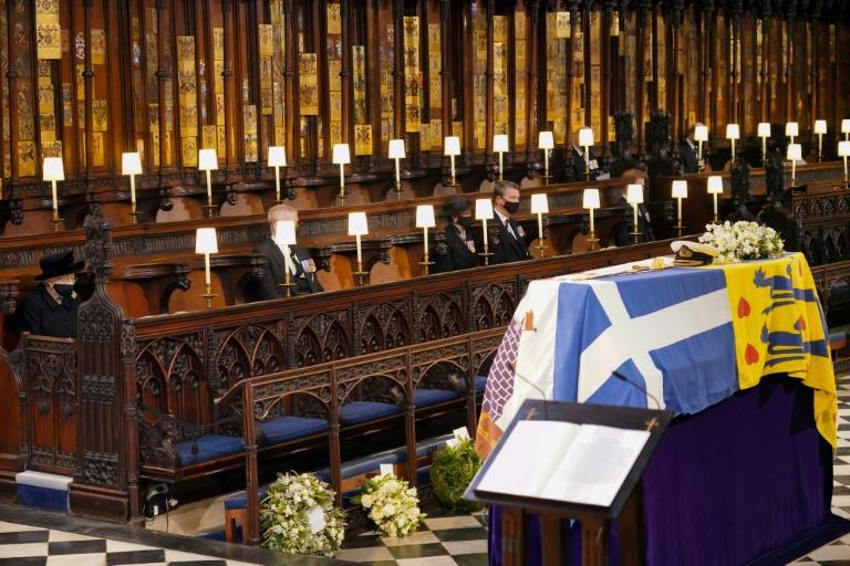 Queen Elizabeth II cut a solitary figure at the funeral of her husband, Prince Philip, which was held in April 2021 under coronavirus restrictions and social distancing rules (AFP/Jonathan Brady)