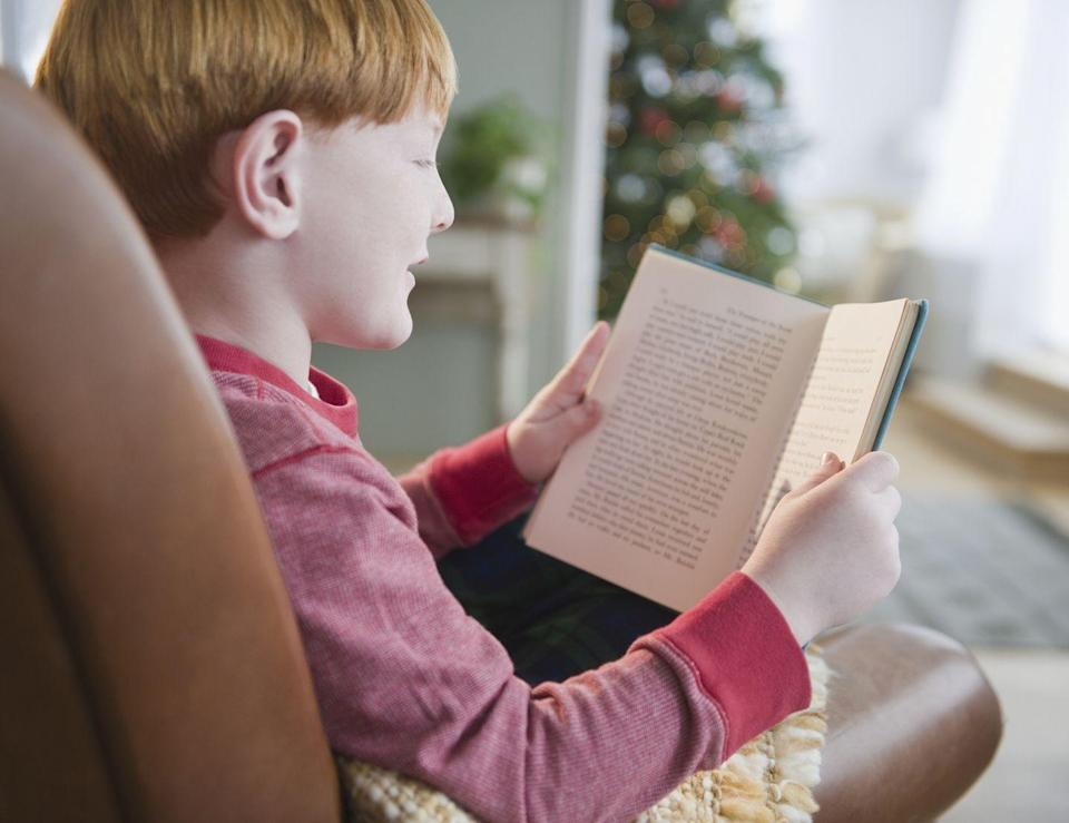 """<p>If you've got any new readers in your group, ask them to show off their skills — and build their literacy confidence — by reading aloud to the whole family. Pick a Christmas book or poem, such as """"The Night Before Christmas."""" For shy readers, the family dog makes a willing audience. </p><p><strong>RELATED:</strong> <a href=""""https://www.goodhousekeeping.com/holidays/christmas-ideas/g23743657/christmas-books/"""" rel=""""nofollow noopener"""" target=""""_blank"""" data-ylk=""""slk:30+ Best Christmas Books for Readers of All Ages That Aren't &quot;The Night Before Christmas&quot;"""" class=""""link rapid-noclick-resp"""">30+ Best Christmas Books for Readers of All Ages That Aren't """"The Night Before Christmas""""</a> <br></p>"""