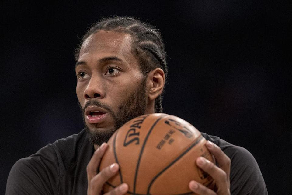 San Antonio Spurs forward Kawhi Leonard holds the basketball world in his massive hands this summer. (Getty Images)