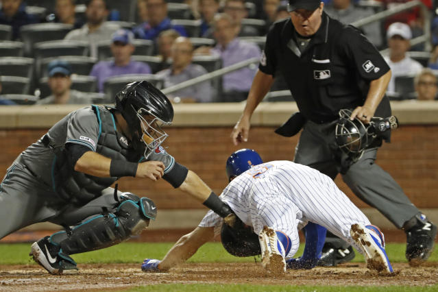 Arizona Diamondbacks catcher Alex Avila tags out New York Mets' Brandon Nimmo at the plate as home plate umpire Doug Eddings watches during the fourth inning of a baseball game Tuesday, Sept. 10, 2019, in New York. (AP Photo/Kathy Willens)