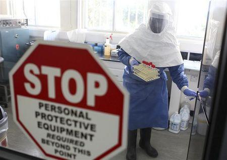A doctor works in a laboratory on collected samples of the Ebola virus at the Centre for Disease Control in Entebbe