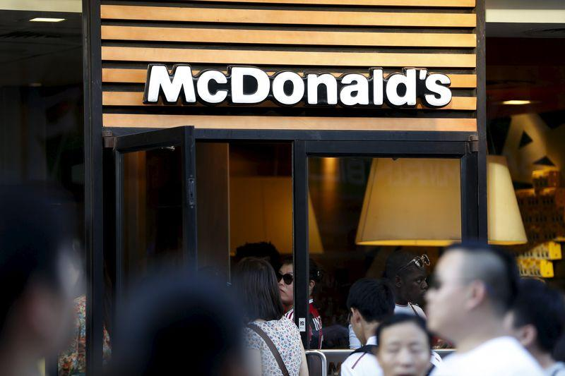 People walk past the entrance to a McDonald's restaurant in Shanghai