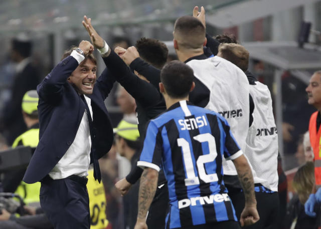 Inter Milan's head coach Antonio Conte celebrates with his team players during a Serie A soccer match between AC Milan and Inter Milan, at the San Siro stadium in Milan, Italy, Saturday, Sept.21, 2019. (AP Photo/Luca Bruno)