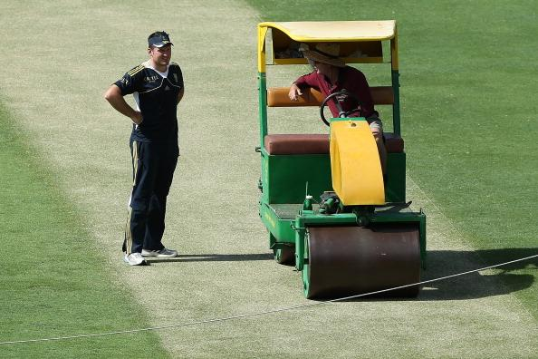 BRISBANE, AUSTRALIA - NOVEMBER 06:  Graeme Smith inspects the pitch during a South African training session at The Gabba on November 6, 2012 in Brisbane, Australia.  (Photo by Chris Hyde/Getty Images)