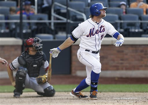 New York Mets' Kirk Nieuwenhuis (9) watches his home run during the 14th inning of a baseball game against the Arizona Diamondbacks on Thursday, July 4, 2013, in New York. (AP Photo/Frank Franklin II)
