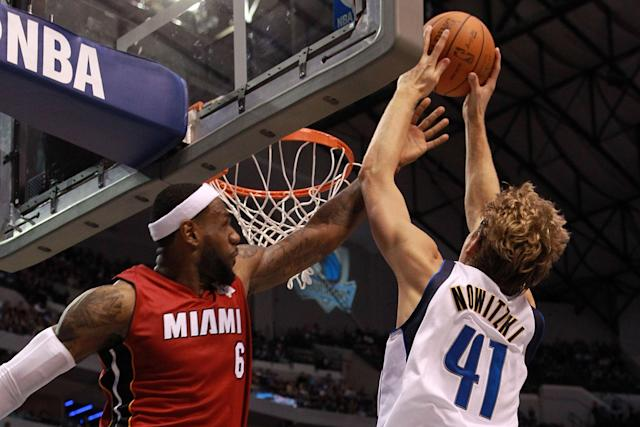DALLAS, TX - DECEMBER 25: LeBron James #6 of the Miami Heat fouls Dirk Nowitzki #41 of the Dallas Mavericks during the NBA season opening game at American Airlines Center on December 25, 2011 in Dallas, Texas. NOTE TO USER: User expressly acknowledges and agrees that, by downloading and/or using this Photograph, user is consenting to the terms and conditions of the Getty Images License Agreement. (Photo by Ronald Martinez/Getty Images)