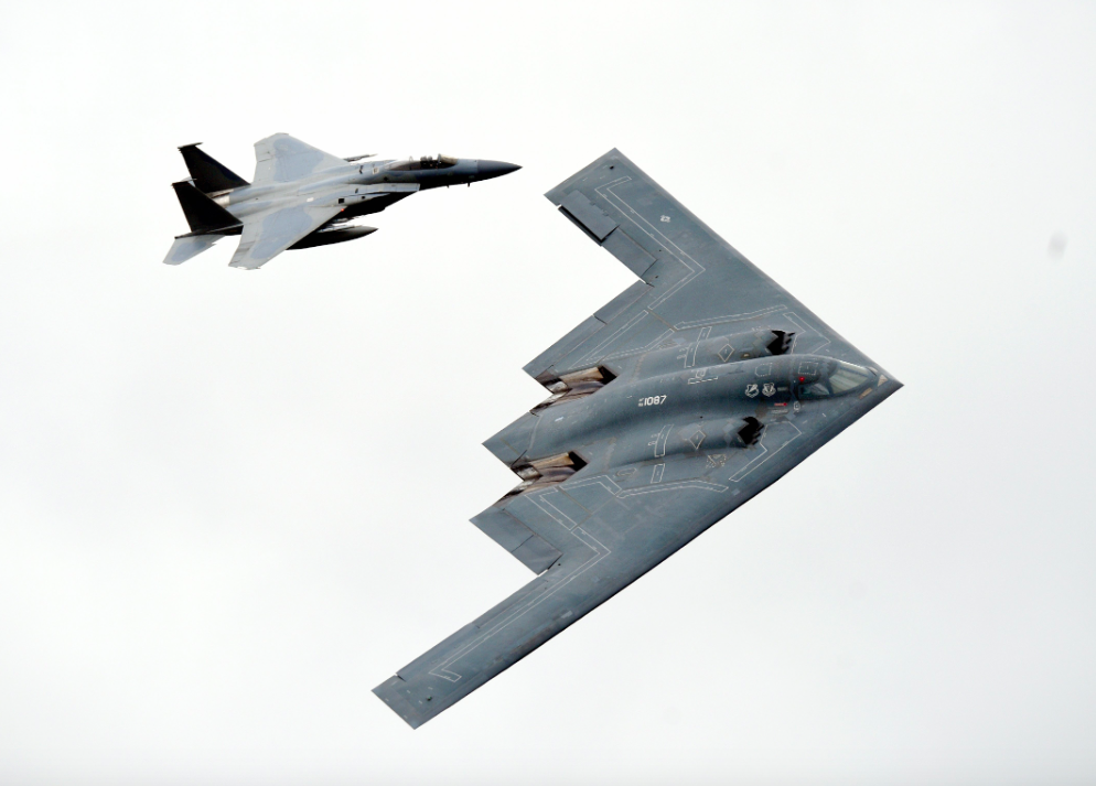 <p>The bomber was joined by two F-15 Eagle fighter jets. (Pic: SWNS) </p>