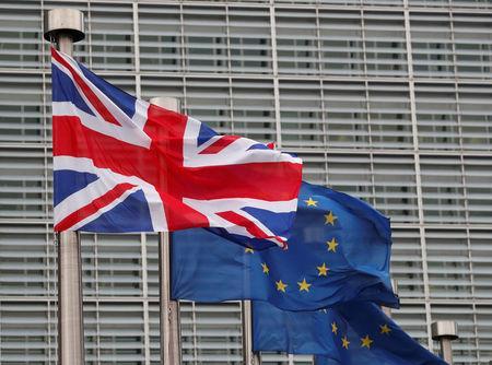 FILE PHOTO: A Britain's and some European flags are hung outside the EU Commission headquarters in Brussels