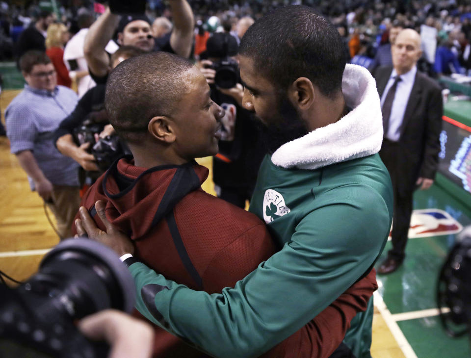 Boston Celtics guard Kyrie Irving (right) embraces Cleveland Cavaliers guard Isaiah Thomas after a Jan. 3, 2018, game. (AP)