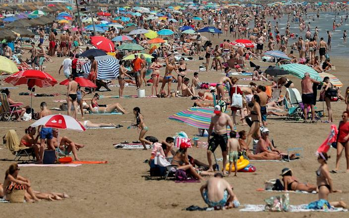 A crowded beach in Valencia - Kai FÃrsterling/EPA-EFE/Shutterstock
