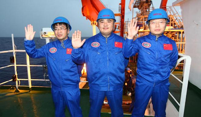 Professor Liu Kaizhou (left) with colleagues Ye Cong and Yang Bo, was instrumental in the success of China's Jiaolong manned submersible. Photo: Xinhua