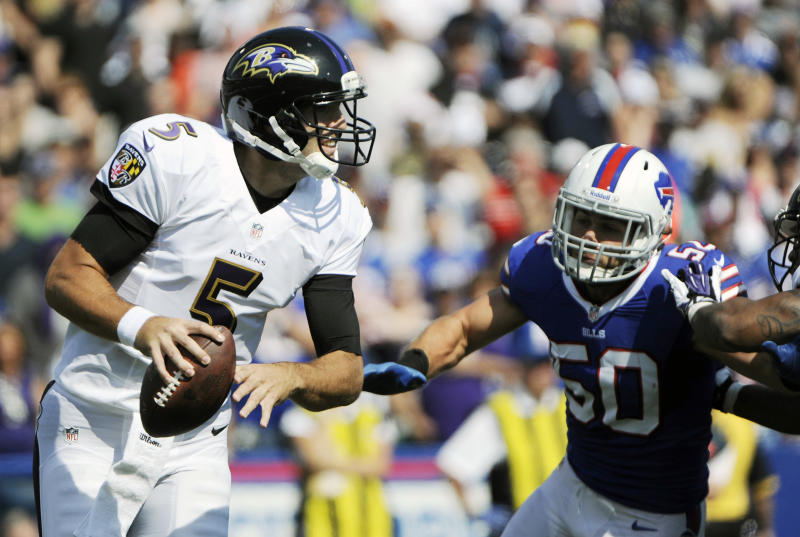 Baltimore Ravens quarterback Joe Flacco (5) runs under pressure from Buffalo Bills middle linebacker Kiko Alonso (50) during the first half of an NFL football game on Sunday, Sept. 29, 2013, in Orchard Park, N.Y. (AP Photo/Gary Wiepert)
