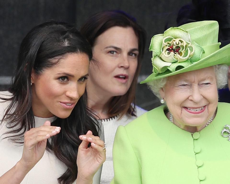 Samantha Cohen can be seen in the background of this photo, taken during Meghan and the Queen's visit to Cheshire [Photo: PA]
