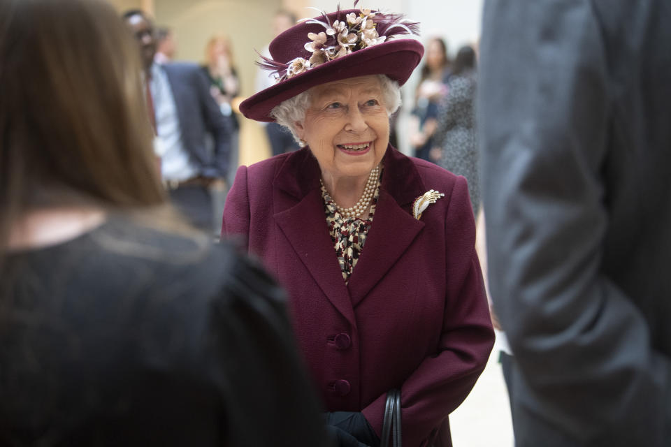 Queen Elizabeth II talks with MI5 officers during a visit to the headquarters of MI5 at Thames House in London.