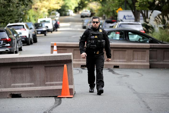 <p>U.S. Secret Service Uniform Division officers stand guard at the end of the block where former President Barack Obama and his family live and where an explosive device was sent Oct. 24, 2018 in Washington, D.C. (Photo: Chip Somodevilla/Getty Images) </p>