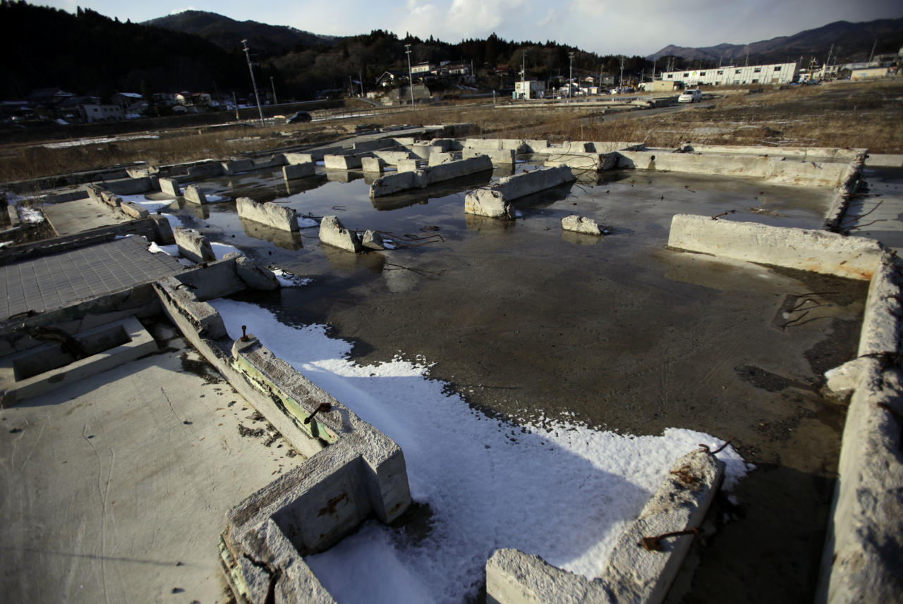 In this Saturday, Feb. 23, 2013 photo, foundations of houses are seen in an area devastated by the March 11, 2011 earthquake and tsunami in Kesennuma, Miyagi Prefecture. Japan's progress in rebuilding from the tsunami that thundered over coastal sea walls, sweeping entire communities away, is mainly measured in barren foundations and empty spaces. Clearing of forests on higher ground due to be leveled to make space for relocating survivors has barely begun. Japan will next week observes two years from the March 11, 2011 disasters which devastated in the northeastern Pacific coast of the country. (AP Photo/Junji Kurokawa)