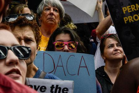 FILE PHOTO: People participate in a protest in defense of the Deferred Action for Childhood Arrivals program or DACA in New York, U.S., September 9, 2017. REUTERS/Stephanie Keith