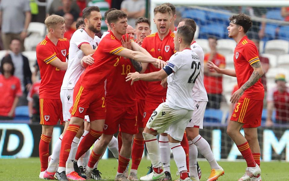 Wales' defender Chris Mepham (CL) pushes Albania's midfielder Amir Abrashi (CR) away from a melee during the international friendly football match between Wales and Albania at Cardiff City Stadium in Cardiff, South Wales, on June 5, 2021. - GETTY IMAGES