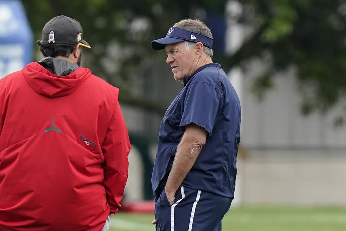 New England Patriots head coach Bill Belichick, right, speaks with Matt Patricia, left, during an NFL football practice, Tuesday, June 15, 2021, in Foxborough, Mass. (AP Photo/Steven Senne)
