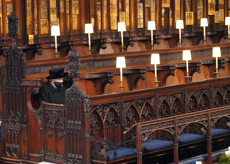Queen sitting alone at funeral (PA Wire)