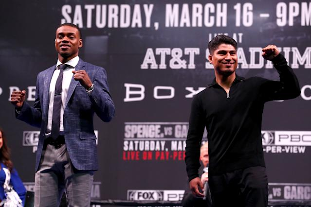 Errol Spence and Mikey Garcia pose for the crowd during a news conference in Los Angeles in February. (Getty Images)