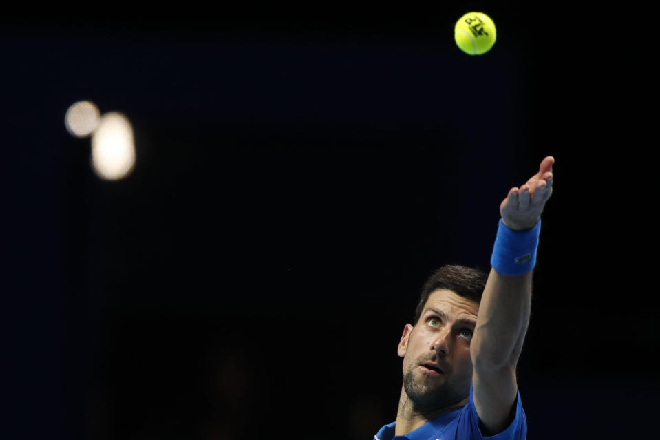 Novak Djokovic of Serbia serves to Diego Schwartzman of Argentina during their singles tennis match at the ATP World Finals tennis tournament at the O2 arena in London, Monday, Nov. 16, 2020. (AP Photo/Frank Augstein)