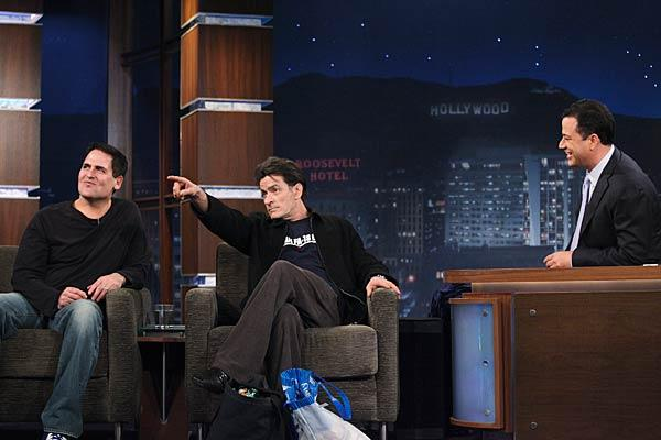 "Charlie Sheen decided he needed just a little more of the spotlight Monday night when he made a surprise appearance on ""Jimmy Kimmel Live."" The actor -- who is currently embroiled in a $100 million lawsuit with his former ""Two and a Half Men"" bosses -- stormed on stage during Dallas Mavericks owner Mark Cuban's guest spot to raucous applause from the audience. Richard Cartwright/ABC"