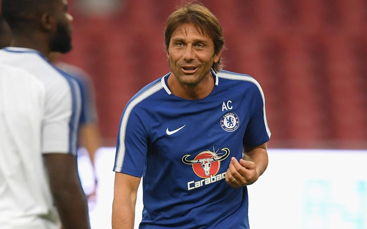 """It was during his family holiday in Liguria, the coastal retreat located in the north-west of Italy, when serious doubts over Antonio Conte's Chelsea future first began to emerge. Conte was a Premier League champion, revered for delivering his remit of a return to European football, but it was a period of introspection as he spent his break snorkelling, swimming and considering his next move. He signed a new two-year contract last week, to avert any fears of a surprise departure, yet it has been far from a relaxing summer for Chelsea's head coach. There has been the escalating row with wantaway striker Diego Costa, the frustration of missing out on Romelu Lukaku to Manchester United, while there were even suggestions that Conte was seeking greater power over the club's transfer policy. Premier League done deals: each club's confirmed summer transfers He has demanded more signings during Chelsea's stay in Beijing and outlined how he endured a """"very tough"""" first season in English football, away from wife Elisabetta and Vittoria, his daughter. And when asked if he had ever contemplated walking away, Conte said: """"My decision was always to stay with Chelsea and continue this work. But you know very well that our job is not simple and anything can happen during our path and our career. """"It was a difficult season, a hard season, a very tough season for me and my staff. Now I have decided with the club to continue our path. I spoke with the club and we find the right view about the future of this club. """"I'm happy with this new contract. The club recognised me and the job I did with the players last season. I thought this [two-year contract] is the right way, to continue to give me motivation, to give the club motivation. """"I don't see any problem about this – and we have all the time eventually to extend this contract."""" Antonio Conte during his team's pre-season friendly against Arsenal Credit: AP In another clear sign of his commitment, Conte's family will move to London th"""