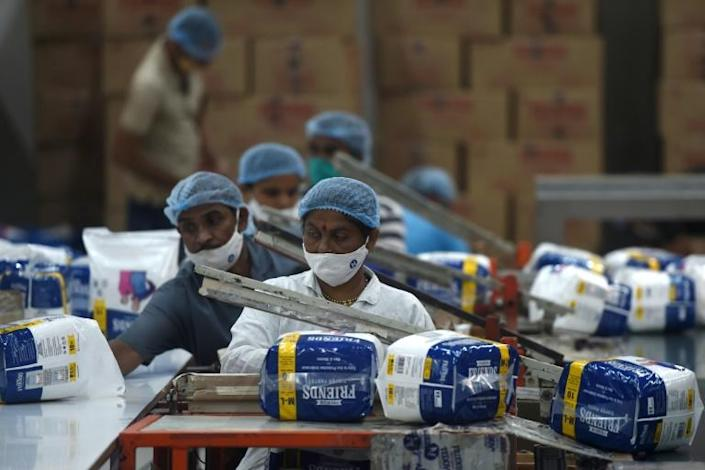 India is on course to top the world in coronavirus cases, but from Maharashtra's whirring factories to Kolkata's thronging markets, people are back at work -- and eager to forget the pandemic for the festival season