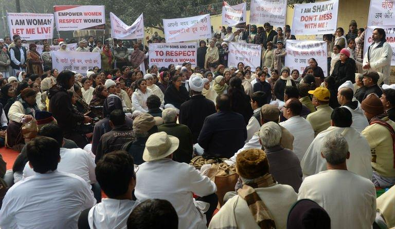 Indians pray for a gang-rape victim during a silent protest in New Delhi on January 1, 2013