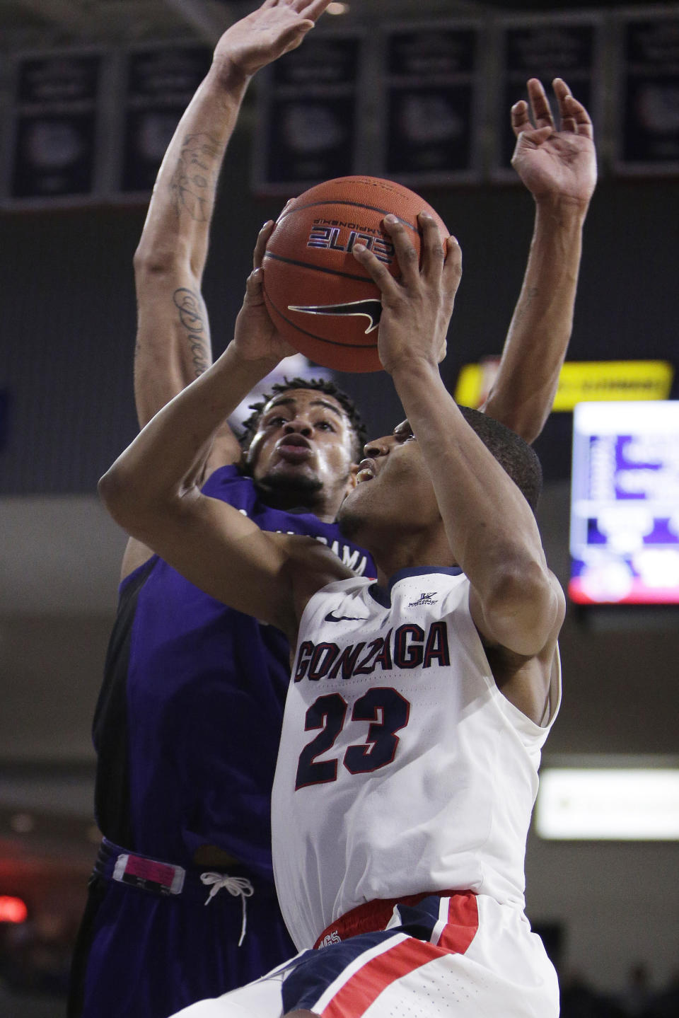 Gonzaga guard Zach Norvell Jr. (23) shoots while defended by North Alabama forward Emanuel Littles during the second half of an NCAA college basketball game in Spokane, Wash., Friday, Dec. 28, 2018. Gonzaga won 96-51. (AP Photo/Young Kwak)