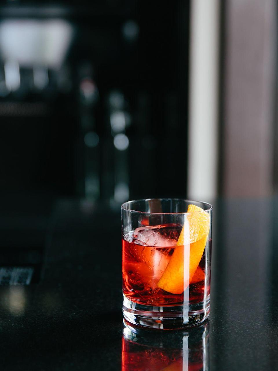"<p><strong>Ingredients</strong></p><p>1 oz Campari<br>1 oz 1757 Vermouth di Torino Rosso<br>1 oz Bulldog Gin</p><p><strong>Instructions</strong></p><p>Build over ice in a rocks glass. Stir for 15 seconds. Garnish with an orange peel or slice.</p><p><strong>More: </strong><a href=""https://www.townandcountrymag.com/leisure/drinks/g2427/negroni-cocktail-recipes/"" rel=""nofollow noopener"" target=""_blank"" data-ylk=""slk:10 Variations on the Negroni to Get You Through Cocktail Hour This Summer"" class=""link rapid-noclick-resp"">10 Variations on the Negroni to Get You Through Cocktail Hour This Summer</a> </p>"