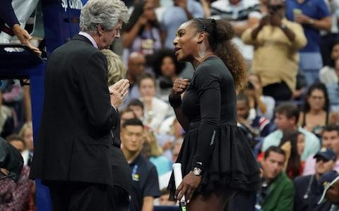 <span>Williams with tournament referee Brian Earley</span> <span>Credit: Getty Images </span>