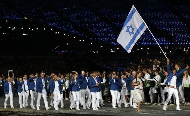 The issue proved a diplomatic headache for IOC President Jacques Rogge, who had hoped to end the debate with a surprise tribute to the victims in the Olympic village in London. Israel's flag bearer Shahar Zubari holds the national flag as he leads the contingent in the athletes parade during the opening ceremony of the London 2012 Olympic Games at the Olympic Stadium July 27, 2012.
