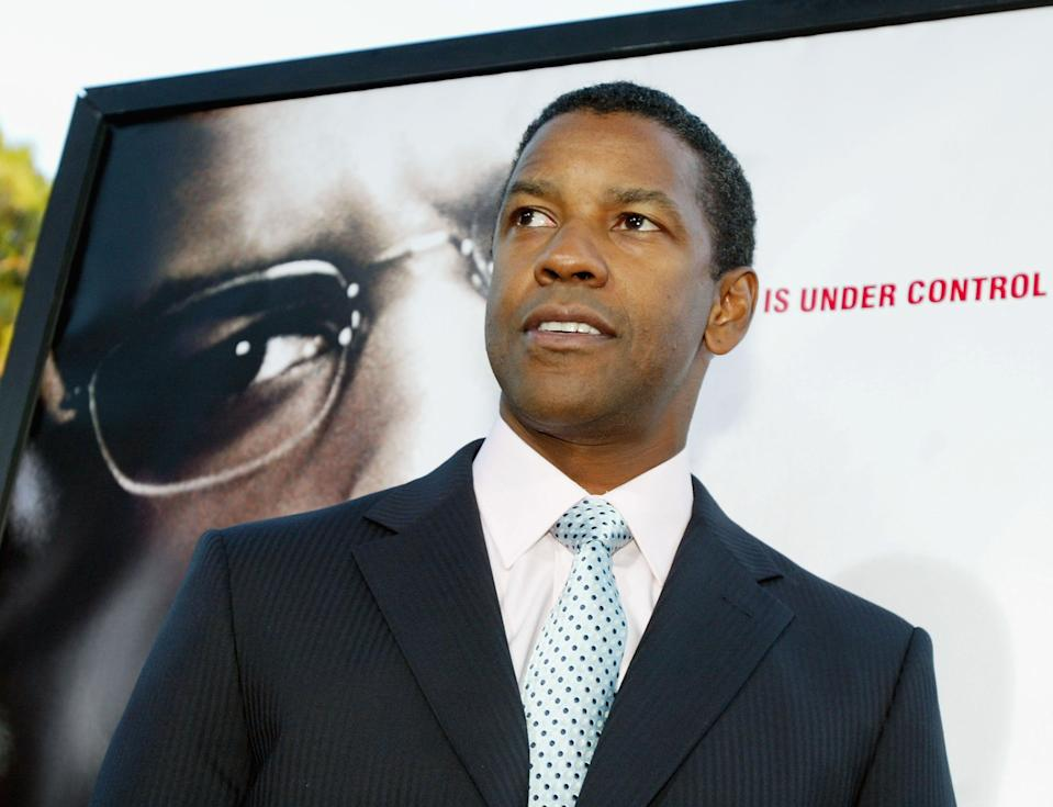 """BEVERLY HILLS, CA - JULY 22:  Actor Denzel Washington arrives at the premiere of Paramounts' """"The Manchurian Candidate"""" on July 22, 2004 at the Samual Goldwyn Theater, in Beverly Hills, California. (Photo by Kevin Winter/Getty Images)"""