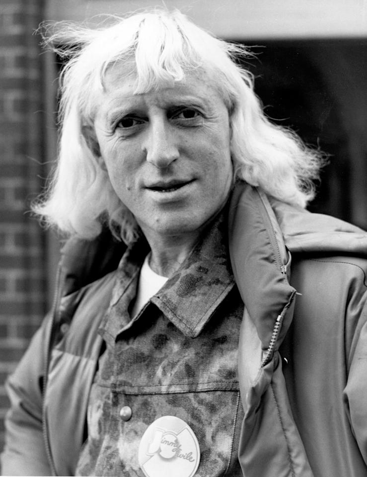 1973:  (FILE PHOTO) Jimmy Savile, 84, has reportedly died on October 29, 2011. Please refer to the following profile on Getty Images Archival for further imagery.  http://www.gettyimages.co.uk/Search/Search.aspx?EventId=131000729&EditorialProduct=News  Jimmy Savile OBE, British disc jockey, television broadcaster and charity fundraiser looks on on Novemkber 5, 1973.  (Photo by R. Poplowski/Fox Photos/Getty Images)