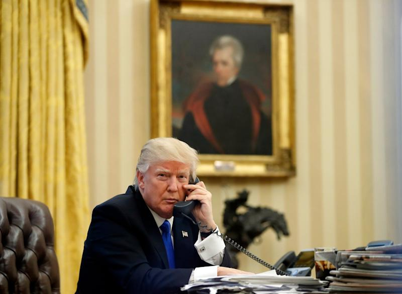 FILE - In this Saturday, Jan. 28, 2017 file photo, President Donald Trump speaks on the telephone with Australian Prime Minister Malcolm Turnbull in the Oval Office of the White House in Washington. In the background is a portrait of former President Andrew Jackson which Trump had installed in the first few days of his administration. President Donald Trump may have raised eyebrows over a series of racist tweets in July 2019 but it's not the first time a U.S. president has sparked attention for racist gestures. (AP Photo/Alex Brandon, File)