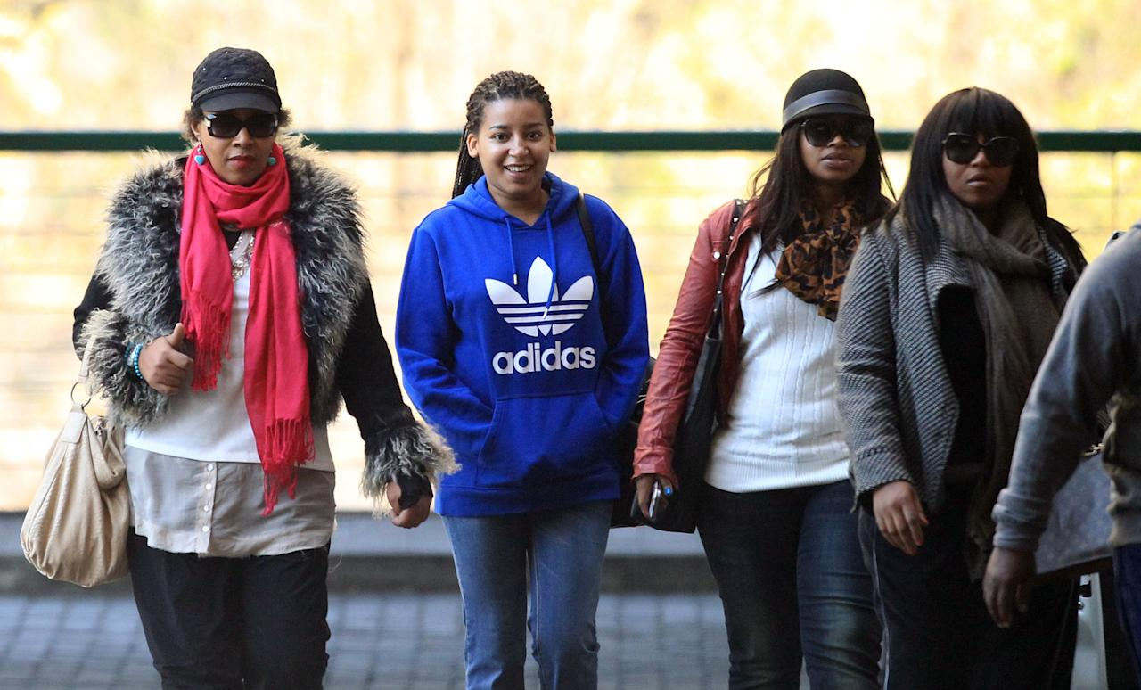 Daughter Zenani Dlamini-Mandela, left, with granddaughters Swati Dlamini, second right, and Zaziwe Dlamini-Manaway, right, and an unidentified family member arrive at the Mediclinic Heart Hospital where former South African President Nelson Mandela is being treated in Pretoria, South Africa Wednesday, June 19, 2013. Mandela remains in the hospital for a ninth day. The 94-year-old was hospitalized for a recurring lung infection. (AP Photo/Themba Hadebe)