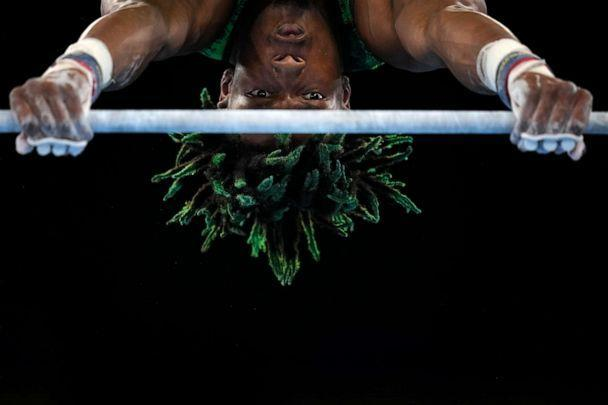 PHOTO: Uche Eke, of Nigeria, competes on the horizontal bar during the men's artistic gymnastic qualifications at the 2020 Summer Olympics, July 24, 2021, in Tokyo, Japan. (Gregory Bull/AP Photo)
