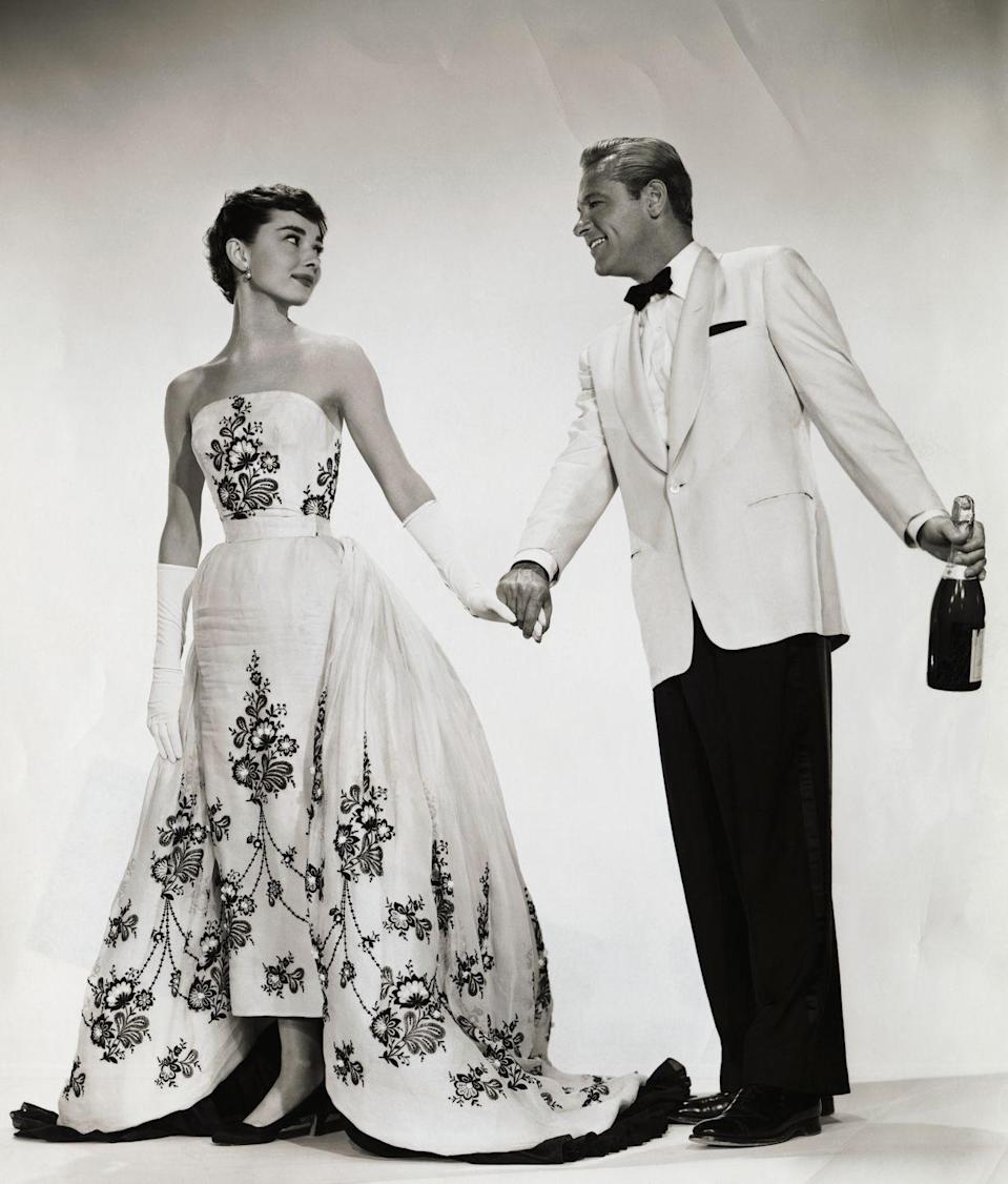 <p>When Audrey Hepburn's character in <em>Sabrina </em>returned to her childhood home as a stunning ingénue, she was outfitted with an entirely new couture wardrobe, including this striking embroidered black-and-white evening gown. </p>