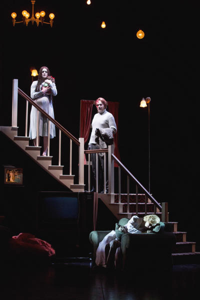"In this Feb. 22, 2013 photo provided by the New York City Opera, cast members perform during a dress rehearsal of ""The Turn of the Screw,"" by the New York City Opera at the Brooklyn Academy of Music in New York. From left are Jennifer Goode Cooper as Miss Jessel; Dominic Armstrong as Peter Quint and Sara Jakubiak as the Governess. (AP Photo/New York City Opera, Richard Termine)"