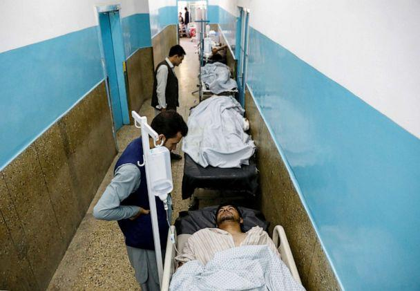 PHOTO: Injured men receive treatment in the hospital after sustaining wounds from a blast at a wedding hall in Kabul, Afghanistan, on Saturday, Aug. 18, 2019. (Mohammad Ismail/Reuters)