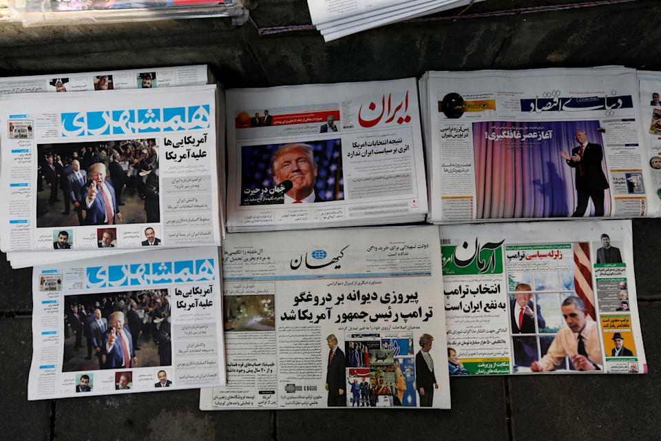 A picture taken on Nov. 10, 2016 in the Iranian capital Tehran shows local newspapers displaying articles on US president-elect Donald Trump a day after his election. (Photo:  Atta Kenare/AFP/Getty Images)