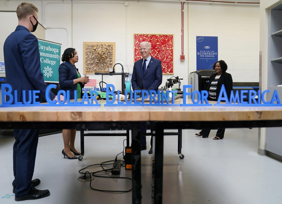 President Joe Biden smiles during a tour of the Cuyahoga Community College Manufacturing Technology Center, Thursday, May 27, 2021, in Cleveland. (AP Photo/Evan Vucci)