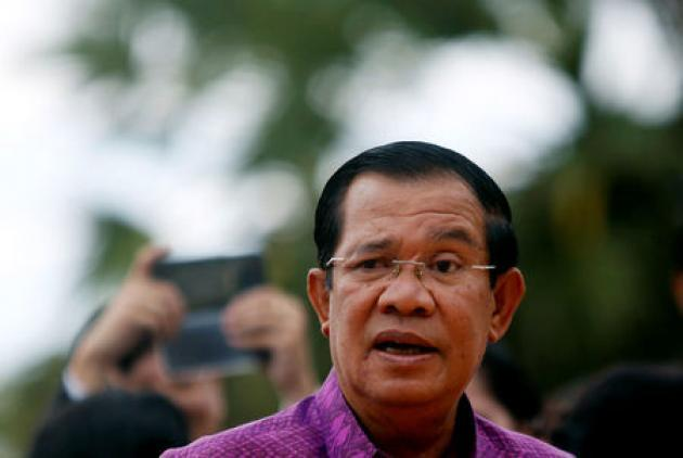 Cambodian PM pulls back on threat to shut rights group founded by rival
