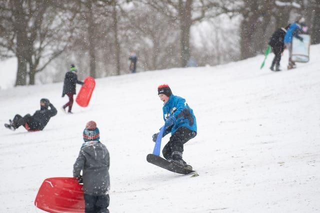 People enjoy the snow at Christchurch Park in Ipswich