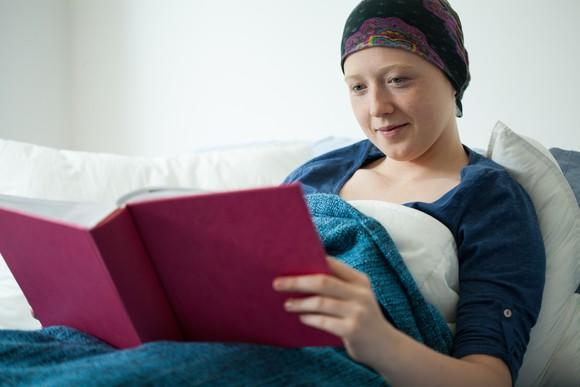 Cancer patient holding a book