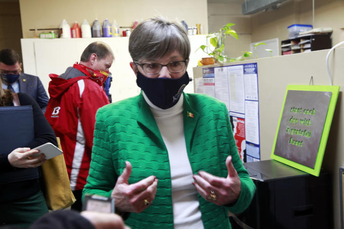 """Kansas Gov. Laura Kelly answers questions from reporters following a tour of a childcare center, Wednesday, March 17, 2021, in Topeka, Kan. The Democratic governor calls a Republican proposal to ban transgender athletes from girls' and women's school sports """"regressive."""" (AP Photo/John Hanna)"""