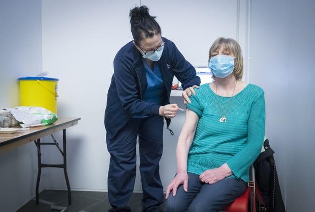 Sarah MacLeod gives Margaret Swift her vaccine