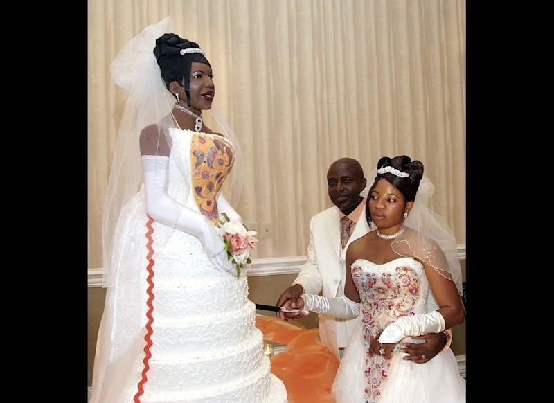 This bride looks good enough to eat. Chidi Ogbuta, right, and her husband, Innocent, cut into an amazing cake -- a life-size version of Chidi in her wedding dress. The 5-foot dessert was served at a celebration after the couple renewed their wedding vows. It contained 200 eggs and 7.5 liters of amaretto, and weighed 400 pounds.